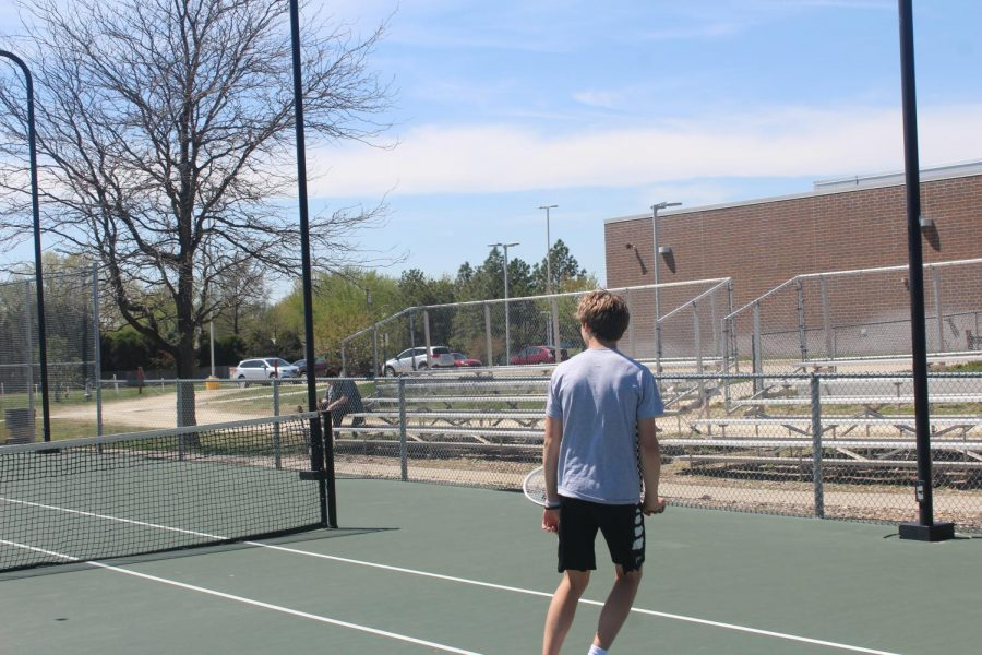 Sophomore Luke Schmidt prepares to hit the ball back over the net.