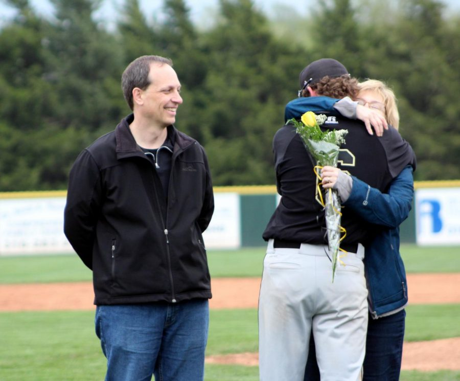 Senior Zachary Kennell gives his mom a hug during senior recognition.