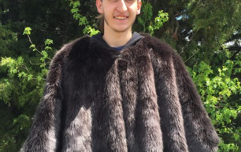 Senior Dominic Ellis shows off his fur used in Asatru traditions, using it as one way to express his religion. Ellis celebrates many holidays surrounding Asatru religion.