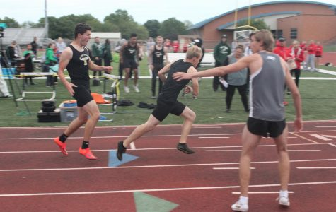 Junior Eli Blaufuss hands off the baton to Senior Joel Thompson.