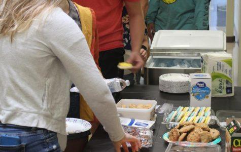 Sophomore Braiden Botterweck takes his turn through the food line.