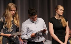Looking at his certificate, senior Matt Seirer stands in between seniors Claire Slechta and Katherine Sebes.