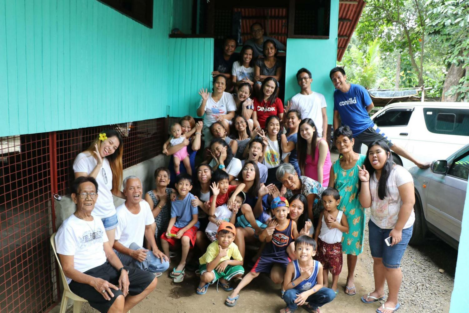 Diane Soguilon and her extended family pose for a group picture before Soguilon, her parents, and her siblings left to move to the U.S.