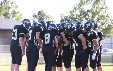 In order to get a first down, the team huddles together and decides what the next play will be.