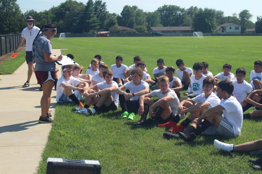 The soccer team meeting up to listen to coach Montano