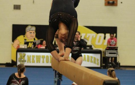 Keeping her balance. junior Toria Thaw comes out of a cartwheel.