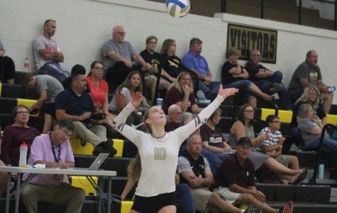 Junior Lindsey Antonowich serves the ball.