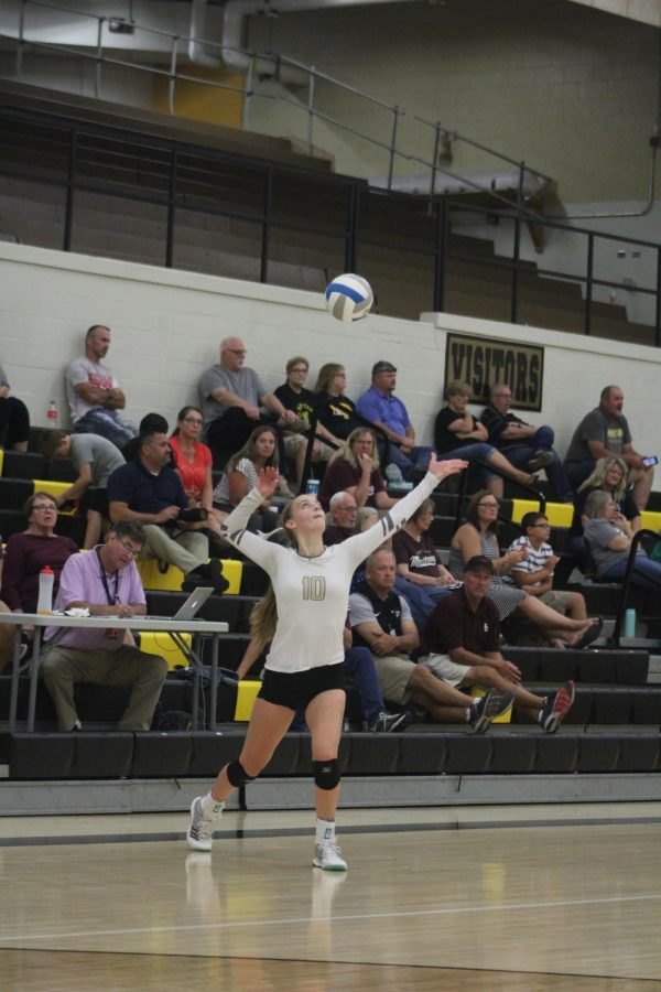 Junior Lindsey Antonowich serves the ball.