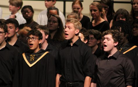 Juniors Josue Coy Dick, Ezekiel Thompson and senior Raistlin Angolo sing together with all the choirs for a final song.
