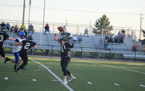 Freshman Jayden Nash throws the ball to his teammate.