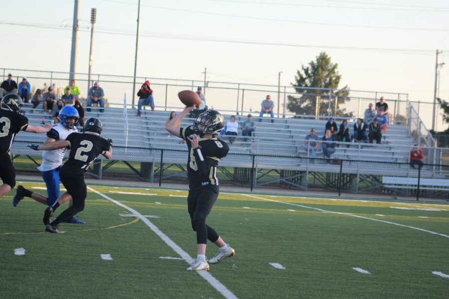 Freshman+Jayden+Nash+throws+the+ball+to+his+teammate.