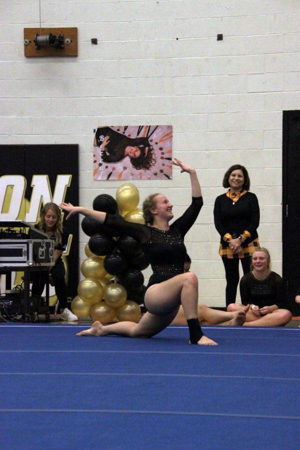 Striking+a+pose%2C+junior+Elise+Jantz+begins+her+floor+routine.