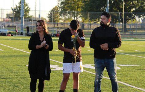 Senior Xander Valdiva accompanied with his parents.