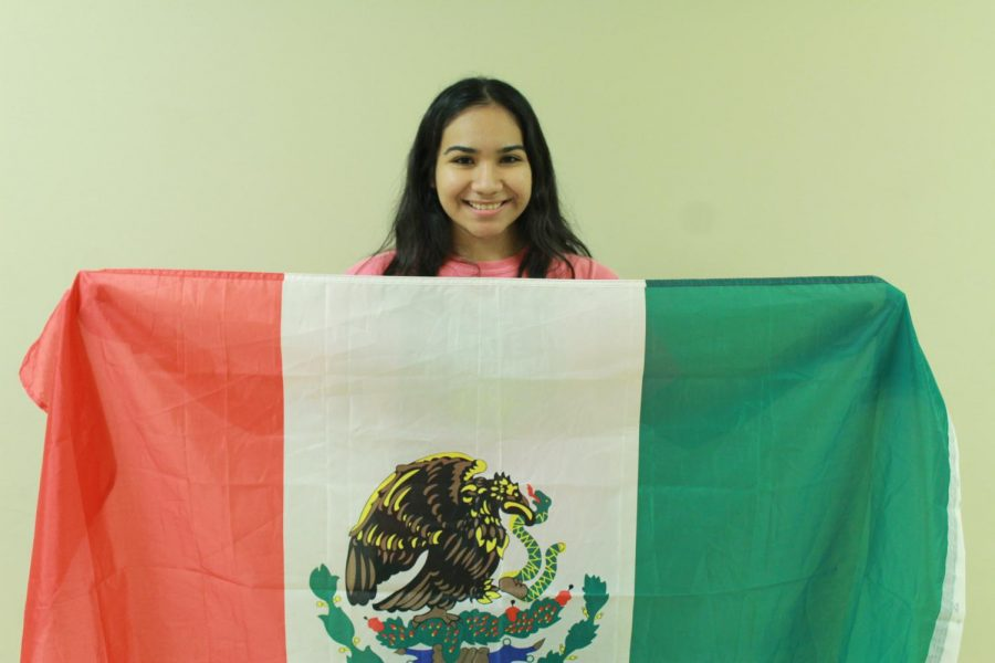 Sophomore Jennifer Rubio poses with the Mexican flag.