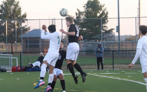 In the air, freshman Collin Hershberger hits a header.