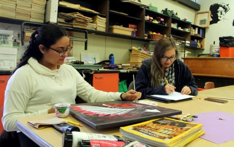 Junior Lourdes Moreno and Jewel Kelly work on their own personal art projects.