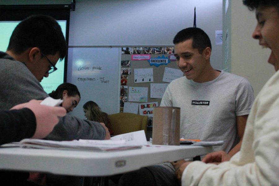 Sophomore Miguel Parga works on a Spanish project with his classmates.
