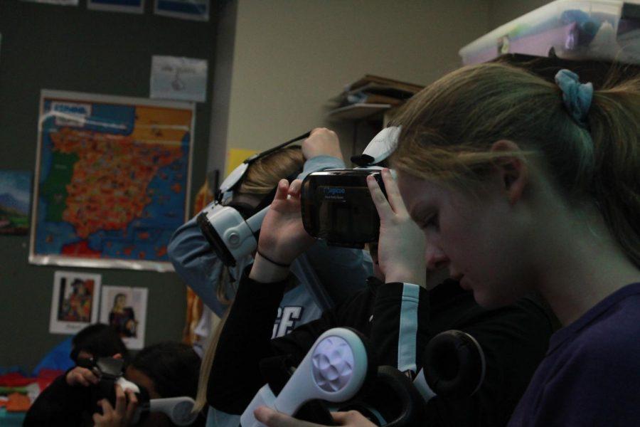 Sophomore Lauren Anton gets ready to put on a VR set.