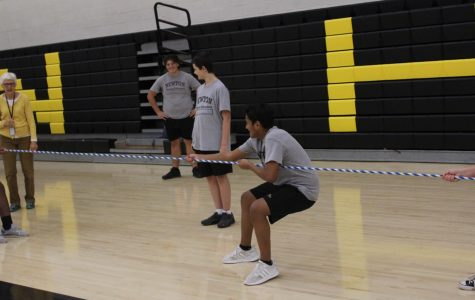 In PE 1 freshman Jiovani Valdivia tugs on the rope so that he and his team can win the game of Tug of War.