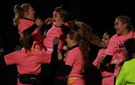 Seniors Molly Stahl and Reagan Moe jumping for joy after Moe scored a touchdown. Seniors ended up winning powderpuff.