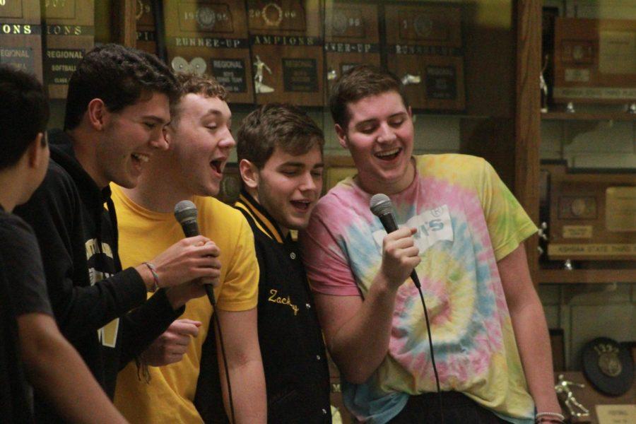Seniors Eli Blaufuss, Drake Henrich, Zach Hill and Kaine Seymour sing Santa Baby.