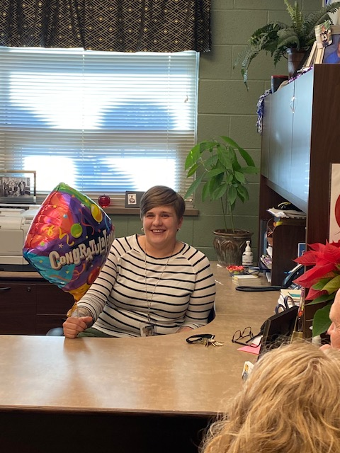 Math teacher Mollie Mills Weis holds her congratulatory balloon after being selected as the Horizon Award winner on Jan. 7 in principal Lisa Moore's office surrounded by her family and colleagues.