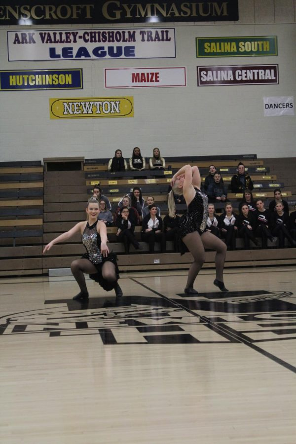 Sophomore Elly Green and junior Evei Bartley strike a pose during their duet.