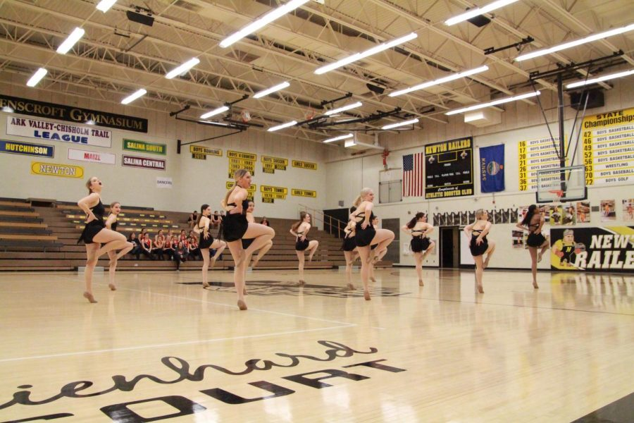 Posing in passé, the Railiners perform a group jazz dance at the home dance competition. The competition was held on Feb. 15, 2020.