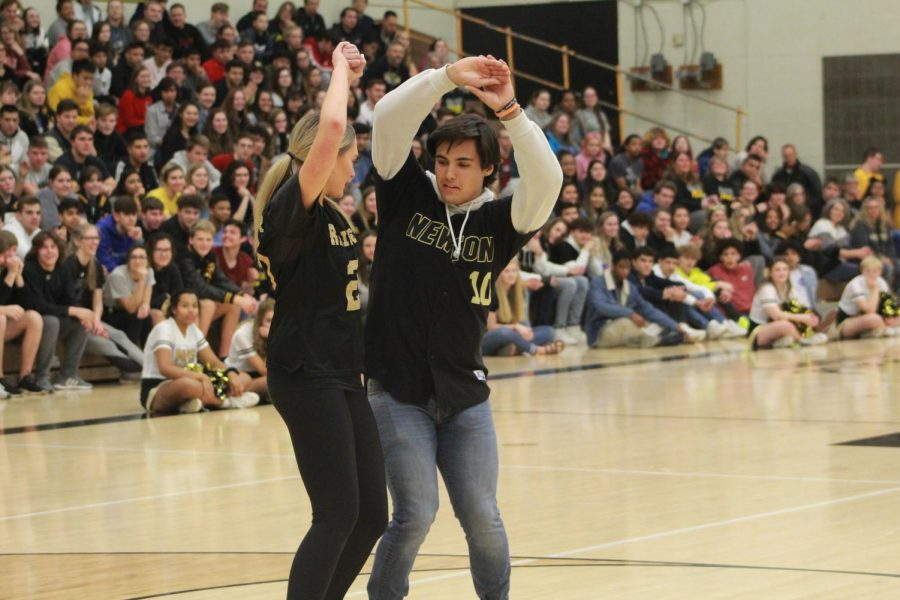 Seniors Chandlor Buffalo and Henry Claassen do their practiced handshake routine in front of the student body.