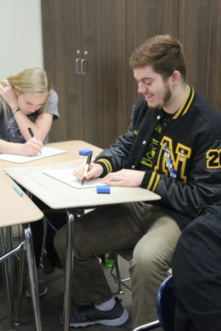 Sophomore Madelynn Hamm and senior Ricardo Lopez work on their task.