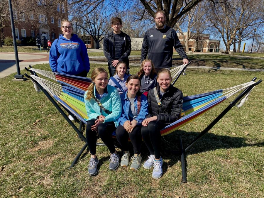 Sports+medicine+students+pose+in+a+hammock+on+the+WSU+campus.