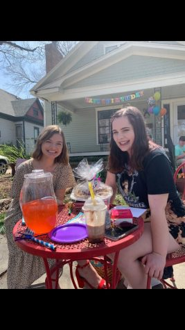 Smiling at the camera, Madyson Groves and Gretchen Otter celebrate around a picnic table for Otter's 18th birthday on April 7. Groves also helped in putting together a video and birthday parade for Otter.