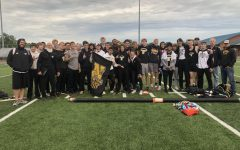 The boys track and field team poses for a picture after winning league in 2019.