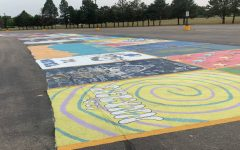 The parking lot is transformed as junior and senior students creatively paint their parking spots.