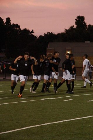 The team celebrates after they score a goal.