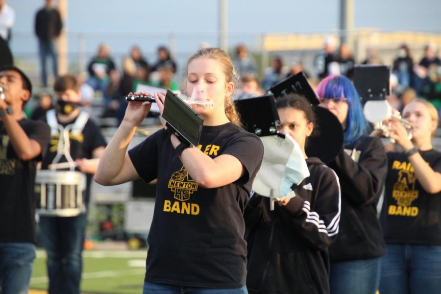 While playing in the Sept. 11 varsity football game, sophomore Preslee Ellette focuses on her music.