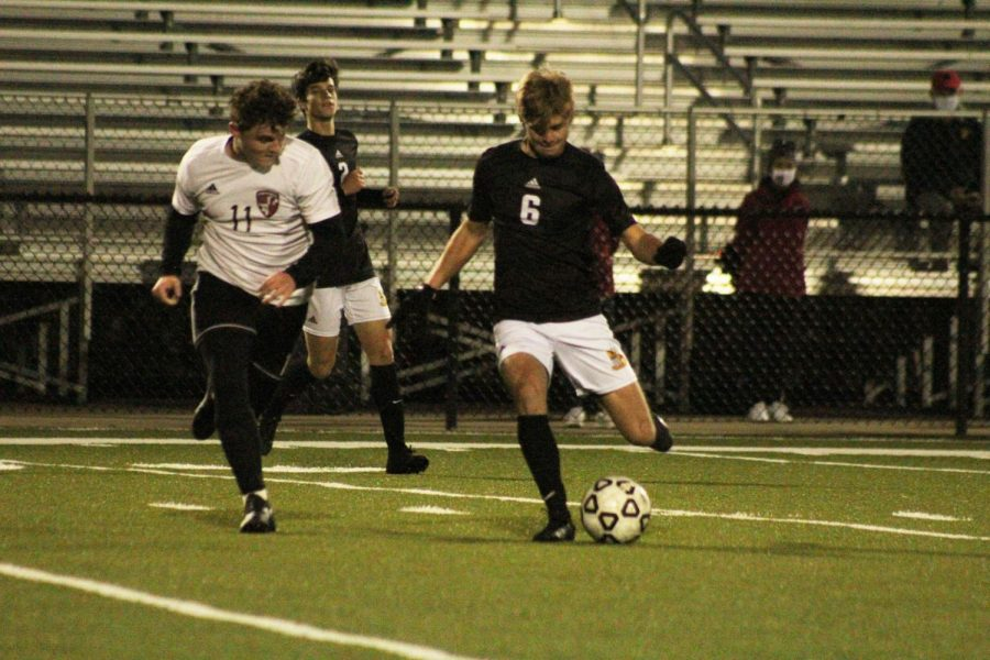 Junior Joel Franz kicks the ball.
