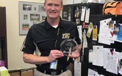 Assistant principal Gregory Dietz poses with this newly obtained award on Dec. 11.