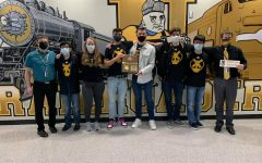 Scholars Bowl participants pose with their Regional Championship plaque after winning the 5A championship on Feb. 1.