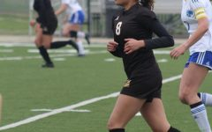 Sophomore Emily Torres runs towards the visitor's goal.