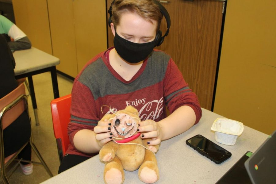 Freshman Levi Baker adjusts the face of his teddy bear creation.