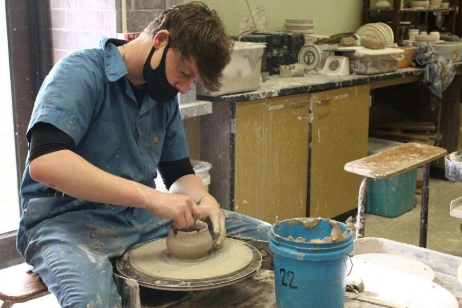 Senior Zane Harder concentrates on his pottery wheel while in Ceramics I.
