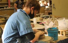 Senior Zane Harder shapes a bowl on the pottery wheel in Ceramics I.