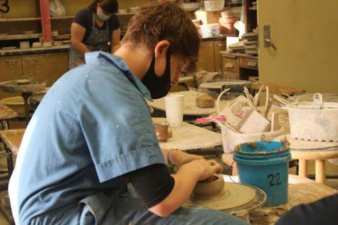 Senior Zane Harder shapes a bowl on the pottery wheel in Ceramics I.
