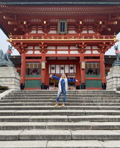 Josie Bacon poses on the steps of Fushimi Inari Taisha, a Shinto shrine located in Kyoto, Japan.