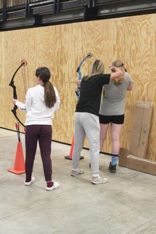 P.E teacher Lisa Antonowich helps freshman Hailey Ryan with her aim.