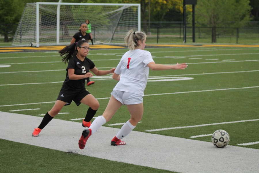 Sophomore Ana Puentes runs after the ball in hopes to gain possession.
