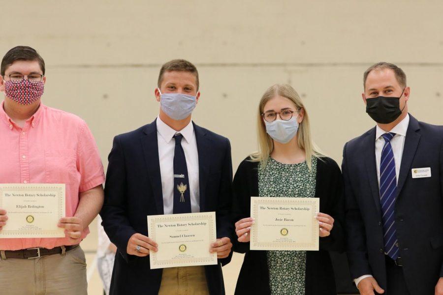 Seniors Eli Redington, Sam Claassen and Josie Bacon pose with their recently received award at senior awards night.