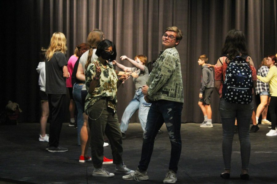 Posing for a picture, seniors Seth Bruey and Dayani Meisel-Silva prepare to start Drama Club activities.