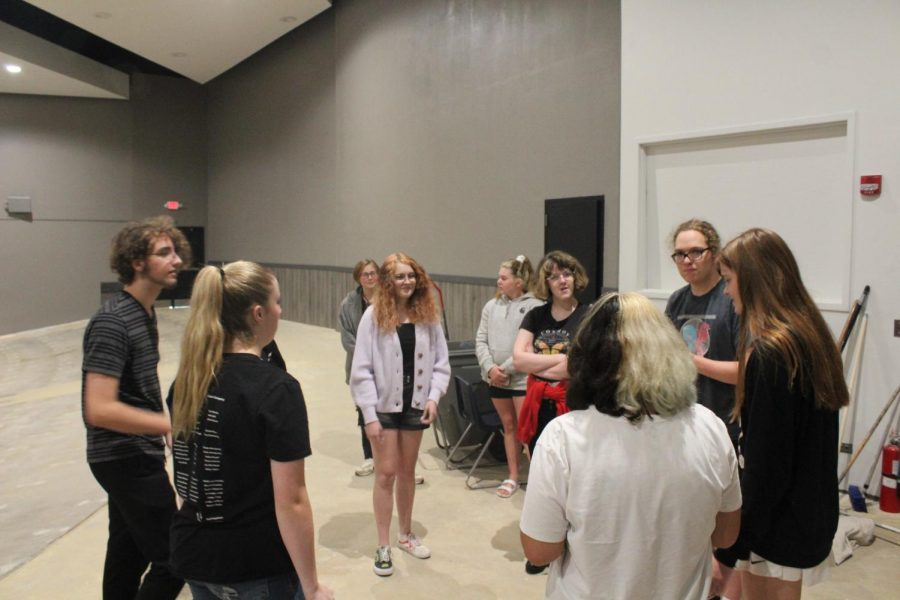 Standing in a circle Drama Club members listen to senior Caleb Garber explain a new activity.